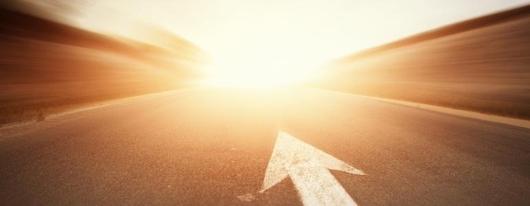 Conceptual image of asphalt road and direction arrow-673380-edited.jpeg