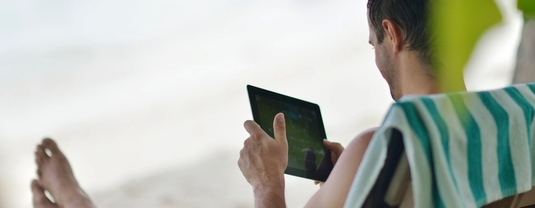 business man relaxing and use tablet computer at beautiful tropical beach-684414-edited.jpeg
