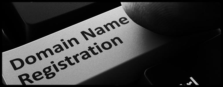 Finger Presses Orange Button  Domain Name Registration on Black Keyboard Background. Closeup View. Selective Focus.-878816-edited.jpeg