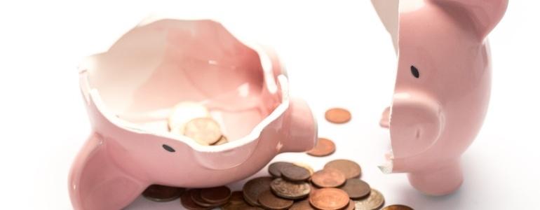 Pink piggy bank broken with money-850168-edited.jpeg